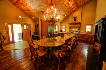 Stettin Haus open floor plan with large island counter top and seating