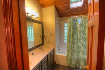 Spacious Full Bath with Jetted Tub and Shower, Double Vanity, Skylight