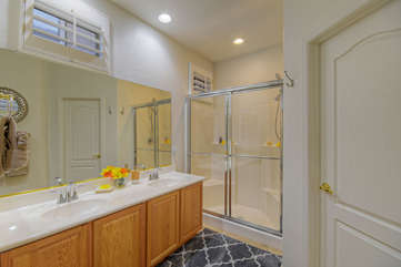 Master suite includes dual vanity skins and walk-in shower with glass doors