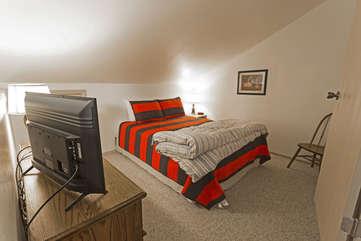 Queen bed loft room
