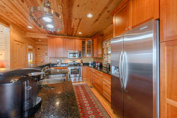 Custom Kitchen with Stainless Appliances and Granite Counters