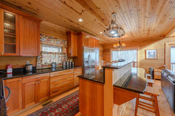 Huge Center Island with Granite Counters and Bar Stool Seating
