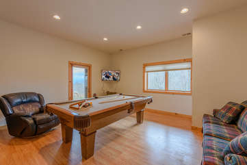 Downstairs Game Room with HDTV and Exterior Door going out into Yard and to Hot Tub