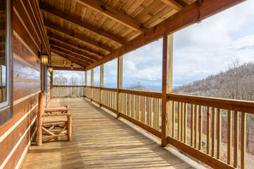 Enjoy Mountain Views and Cross Breezes from the Log Furniture on the Covered Decks