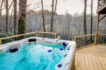 Hot Tub tucked privately down beside Cottage, with River and Mountain Views