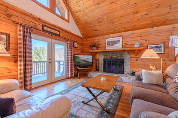 Main Floor Living Room with Stone Fireplace