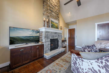 Large HD Smart TV and Gas Log Fireplace in Master Suite