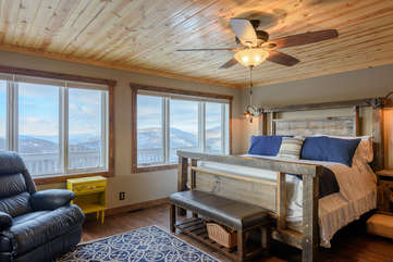 King Master Suite with Wall of Windows framing Mountain Views