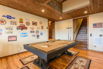 Pool Table centered in Game Room offers lots of elbow room