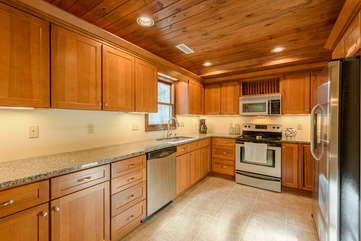 Kitchen with Gorgeous Wood Cabinetry and Stainless Steel Appliances