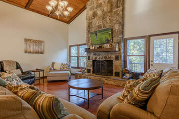 Living Room with Flatscreen TV and Wood Burning Stone Fireplace