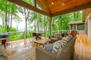 Linville Ridge Retreat deck with outdoor dining, ample seating, fireplace, TV, 2 propane fire pits