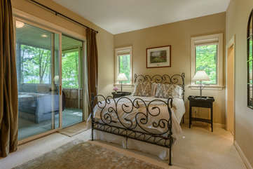 1st Queen Bedroom with private bath, access to hot tub in screened porch