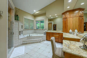 Master Bathroom with tiled walk-in shower, jetted tub, double vanity