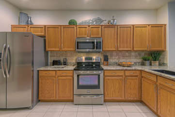 Spacious kitchen has everything you need to prepare and serve your favorite beverages and meals