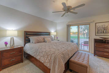 Master bedroom has deluxe king bed and exciting golf course views from room and attached balcony
