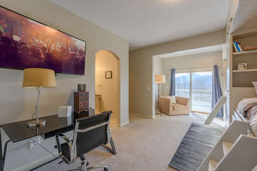 Downstairs Bedroom with Views, Desk, and 55