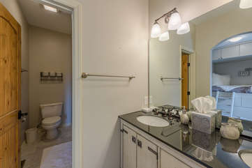 Ensuite Full Bathroom in Downstairs Bedroom with Double Vanity and Tub/Shower