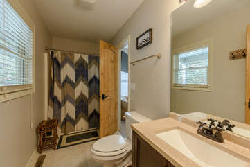 Full Bathroom on Main Level, accessible from Bedroom and Foyer