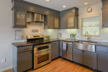 Kitchen boasts Huge Stainless Farm Style Sink and Custom Cabinetry