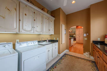 Side Entry with Laundry Machines, Utility Sink, Accessed from Garage and Opens into Kitchen