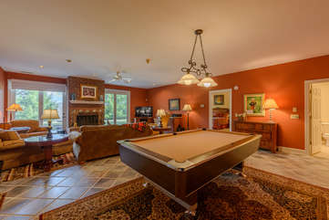Pool Table, TV, Comfortable Seating In Downstairs Den.  Glass Doors access Patio with Hot Tub, Rocking Chairs