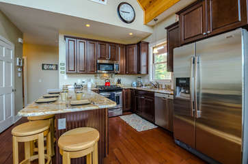 Upscale Stainless Appliances and Ample Custom Cabinetry