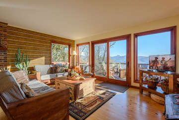 Great Room with HDTV, Wall of Windows framing Mountain Views
