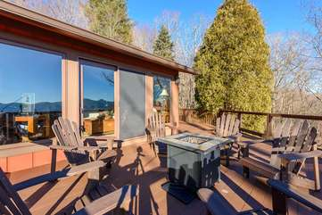 Open Air Patio with Adirondack Seating and Fire Table