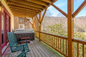 Lower Rear Deck with Hot Tub and Rocking Chairs