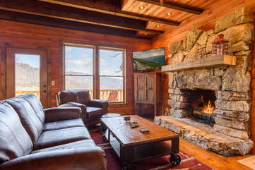 Majestic View living area with gas log fireplace, TV, beautiful views