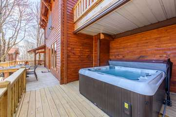 Majestic View large hot tub on covered section of back porch