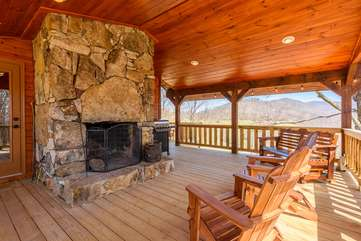 Majestic View covered side deck with wood burning fireplace, grill