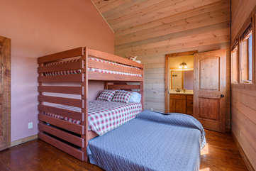 Second upstairs bedroom with Queen bunk beds and Queen-size trundle, private bathroom