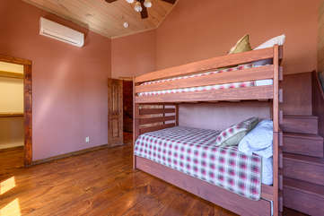 Second upstairs bedroom with bunk beds, large closet, private bath