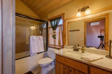 Private bathroom with tub/shower beside bunk room.