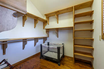 Large walk-in closet with room for pack-n-play accessed through master bathroom