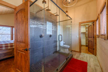 Master bathroom large tiled walk-in shower with dual rain shower heads