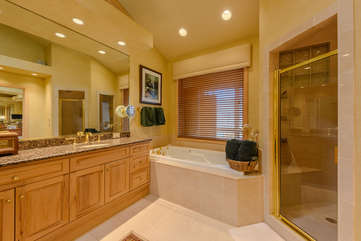 Jetted Jacuzzi Tub and Tile Shower in Master Bathroom