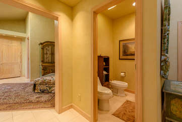 Water Closet with Toilet and Bidet in Master Bathroom