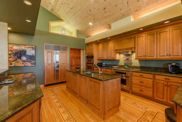 Huge Kitchen with Sub Zero Fridge and Freezer, Double Wall Ovens, Convection and Oven, and Gas Cooktop