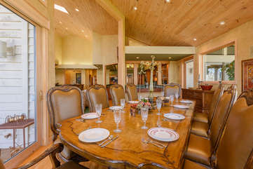 Banquet-style Dining Table seats 10 Guests (10 more can dine at surrounding bar tops and round table)