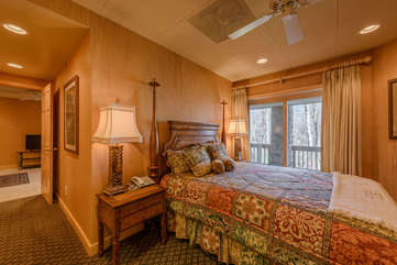 Queen Bed and Sliding Glass Doors in Guest Apartment