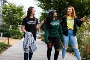 Three Female Students Walking Outside