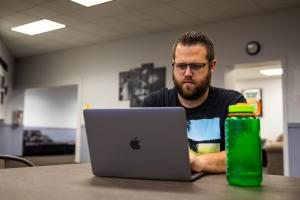 Male Student at Laptop