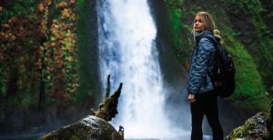 Girl Hiking by Waterfall