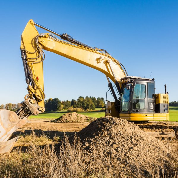 Landscape with a yellow earth mover at a construction site
