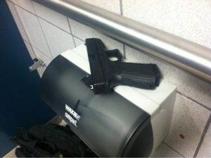 gun in the bathroom stall holster