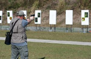 2009_shot_show_-_media_day_at_the_range_-_writer_testing_a_new_handgun