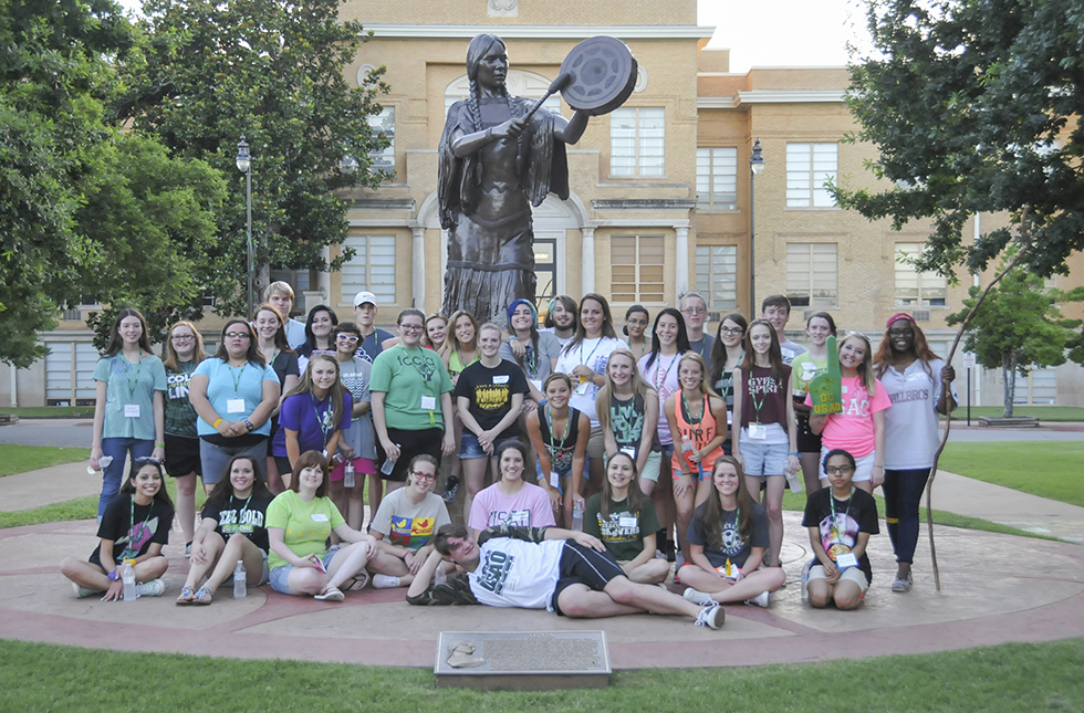 Picture of students gathered in front of the Te Ata statue.